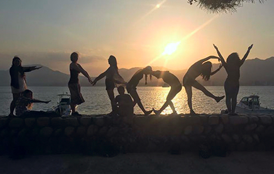 "Students on the ""Seeking Peace"" trip to Japan pose for a photo spelling out ""Emory"" as they visit Miyajima Island near Hiroshima."